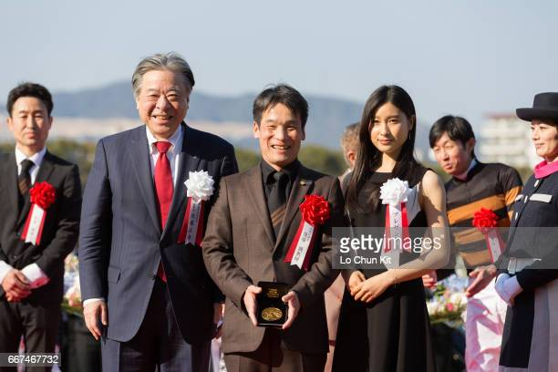 Masayuki Goto President and CEO of Japan Racing Association Hisashi Shimizu trainer of Kitasan Black and Tao Tsuchiya at the presentation ceremony...