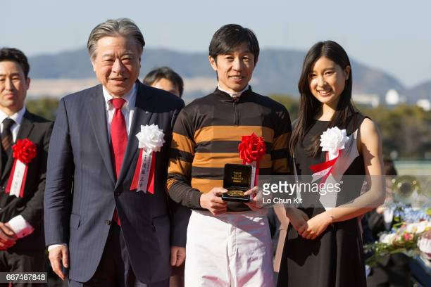 Masayuki Goto President and CEO of Japan Racing Association Yutaka Take jockey of Kitasan Black and Tao Tsuchiya at the presentation ceremony after...