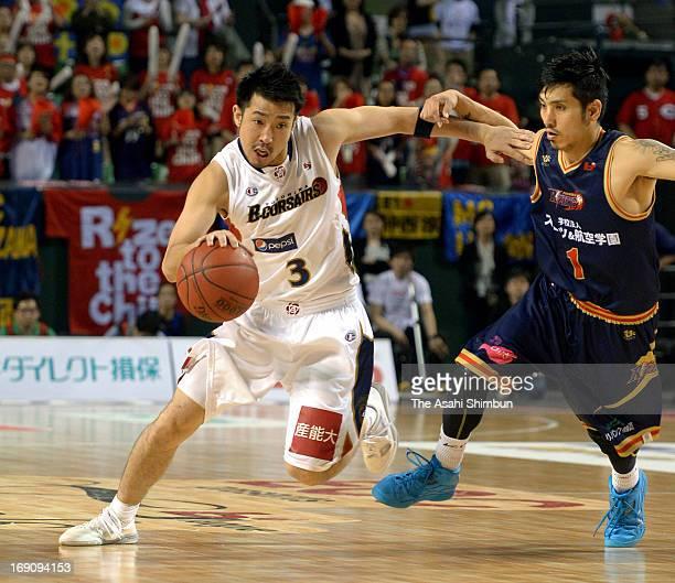 Masayuki Kabaya of Yokohama BCorsairs and Jun Nakanishi of Rizing Fukuoka compete during the bj League playoff final between Yokohama BCorsairs and...