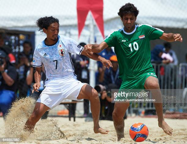 Masayuki Komaki of Japan competes for the ball with Mustafa Ali Joudah of Iraq during day four of the AFC Beach Soccer Championship 2017 match...