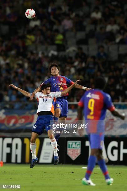 Masayuki Yamada of FC Tokyo and Kisho Yano of Albirex Niigata compete for the ball during the JLeague J1 match between FC Tokyo and Albirex Niigata...