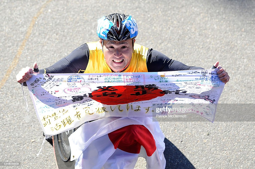 Masazumi Soejima of Japan celebrates after winning the Men's Wheelchair Division in the 42nd ING New York City Marathon in Central Park on November 6, 2011 in New York City.