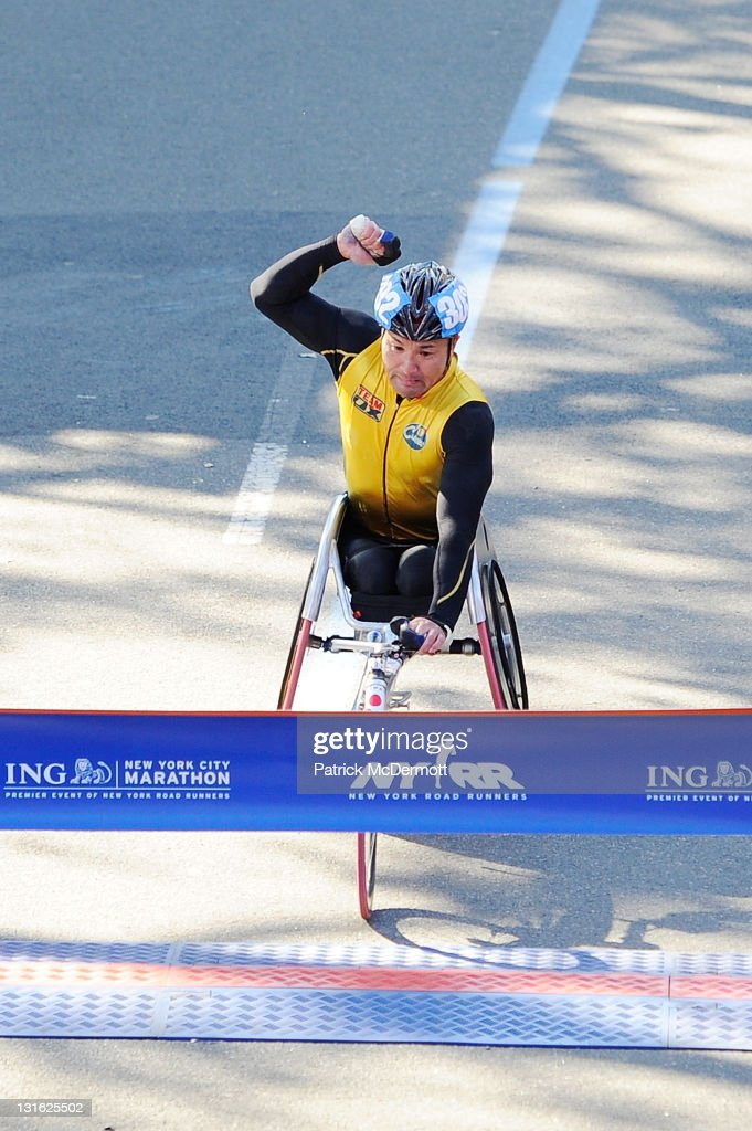 Masazumi Soejima of Japan celebrates as he finishes first in the Men's Wheelchair Division at the 42nd ING New York City Marathon in Central Park on November 6, 2011 in New York City.