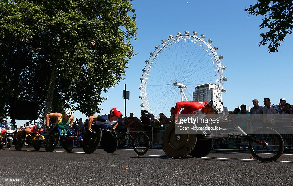 Masazumi Soejima of Japan, David Weir of Great Britain, Kurt Fearnley of Australia and Marcel Hug of Switzerland compete in the Mens T54 Marathon near the London Eye on day 11 of the London 2012 Paralympic Games at Olympic Stadium on September 9, 2012 in London, England.