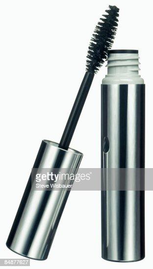 Mascara and brush eye makeup in silver tube