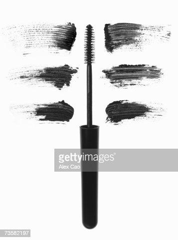 Mascara brush with smudges near it