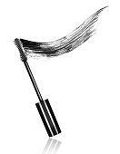 Mascara brushes with mascara stroke close-up, isolated on white background