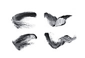 Collection of black mascara isolated on white