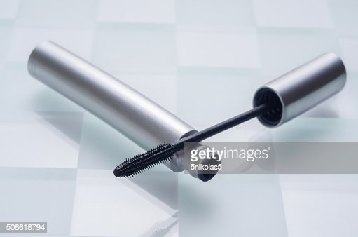 mascara on the chessboard of glass : Stock Photo