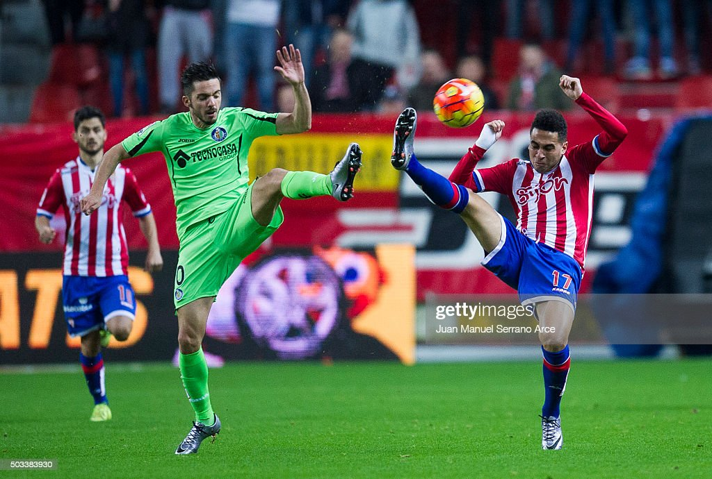 Mascarell of Real Sporting de Gijon duels for the ball with Pablo Sarabia of Getafe CF during the La Liga match between Real Sporting de Gijon and Getafe CF at Estadio El Molinon on January 4, 2016 in Gijon, Spain.