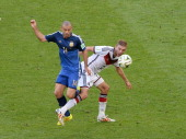 Mascherano of Argentina challenges with Grosskreutz of Germany during the final of the FIFA World Cup 2014 between Germany and Argentina at the...