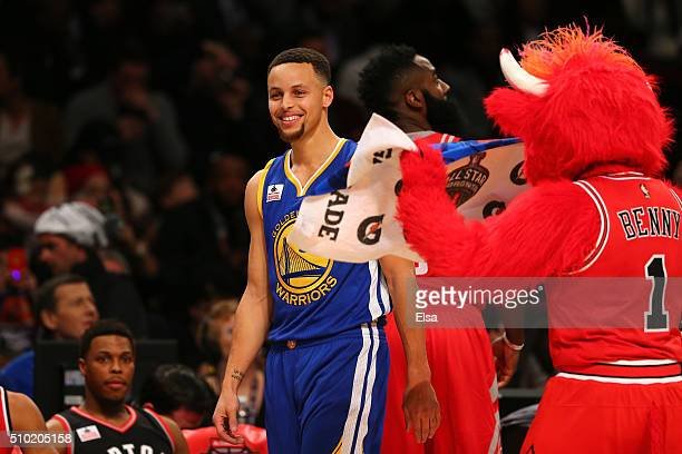 Mascot Benny the Bull of the Chicago Bulls fans Stephen Curry of the Golden State Warriors with a towel in the Foot Locker ThreePoint Contest during...