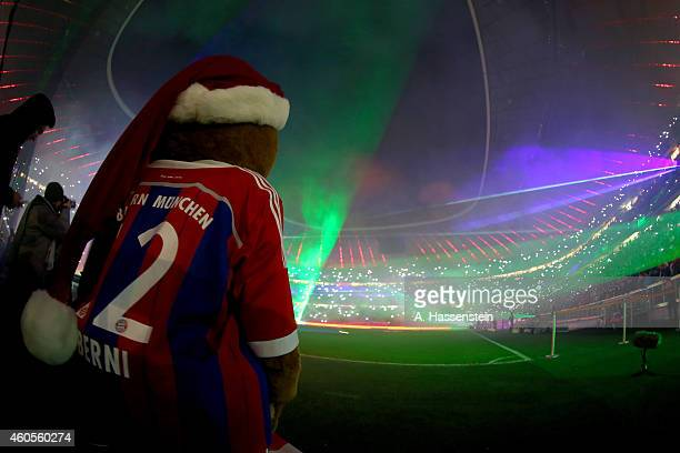 Mascot Bernie of Bayern Muenchen watches a laser show after the Bundesliga match between FC Bayern Muenchen and SC Freiburg at Allianz Arena on...
