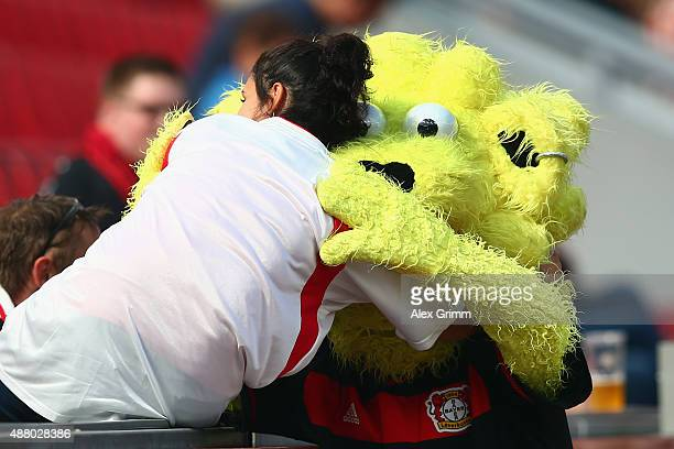 Mascot Brian the Lion of Leverkusen hugs a fan prior to the Bundesliga match between Bayer Leverkusen and SV Darmstadt 98 at BayArena on September 12...