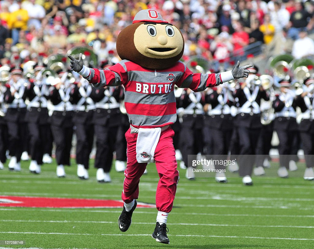 Mascot Brutis the Buckeye takes the field with the Ohio State University marching band before a game with the Colorado Buffaloes at Ohio Stadium in Columbus, Ohio. The Buckeyes won 37 - 17.