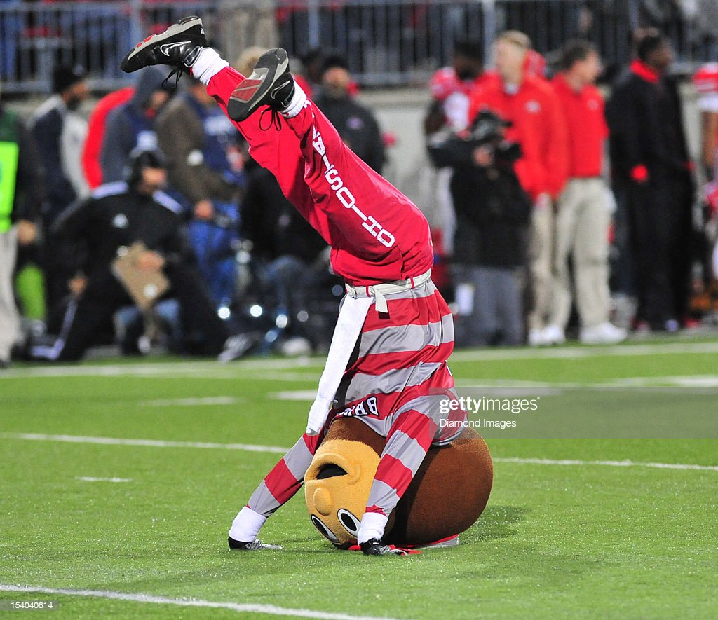 Mascot Brutus the Buckeye cheers on the field during a game between the Ohio State Buckeyes and Nebraska Cornhuskers at Ohio Stadium in Columbus, Ohio. The Ohio State Buckeyes won 63-38.