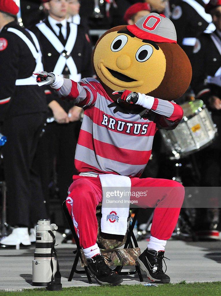 Mascot Brutus the Buckeye cheers on the field during a game between the Ohio State Buckeyes and Nebraska Cornhuskers at Ohio Stadium in Columbus, Ohio. The Ohio State Buckeyes won 63-38.