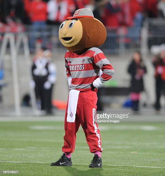 Mascot Brutus the Buckeye dances on the field before a game between the Ohio State Buckeyes and the Penn State Nittany Lions at Ohio Stadium in...