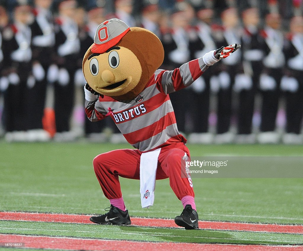 Mascot Brutus the Buckeye dances on the field before a game between the Ohio State Buckeyes and the Penn State Nittany Lions at Ohio Stadium in Columbus, Ohio. The Buckeyes won 63-14.