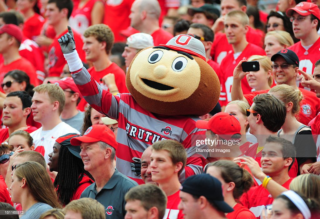 Mascot Brutus the Buckeye of the Ohio State Buckeyes celebrates a touchdown in the Ohio State student section during a game with the Miami Redhawks at Ohio Stadium in Columbus, Ohio. The Buckeyes won 56-10.