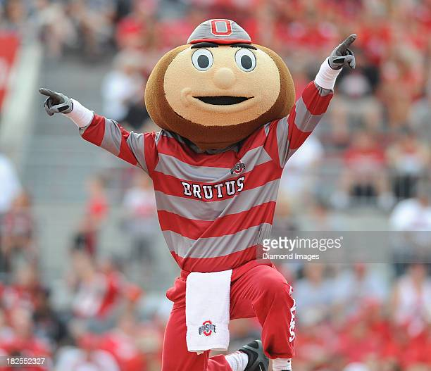 Mascot Brutus the Buckeye of the Ohio State Buckeyes celebrates after doing push ups after a touchdown during a game against the San Diego State...
