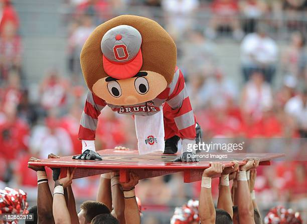 Mascot Brutus the Buckeye of the Ohio State Buckeyes does push ups after a touchdown during a game against the San Diego State Aztecs at Ohio Stadium...