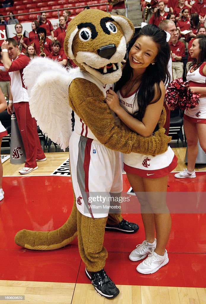 Mascot Butch T. Cougar wearing angel wings is seen with a Washington State Cougars cheerleader prior to the game between the Arizona State Sun Devils and the Washington State Cougars at Beasley Coliseum on January 31, 2013 in Pullman, Washington.