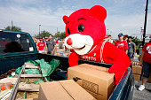 Mascot Clutch of the Houston Rockets players and staff members unload trucks of food and hand it out to victims of Hurricane Ike at a point of...