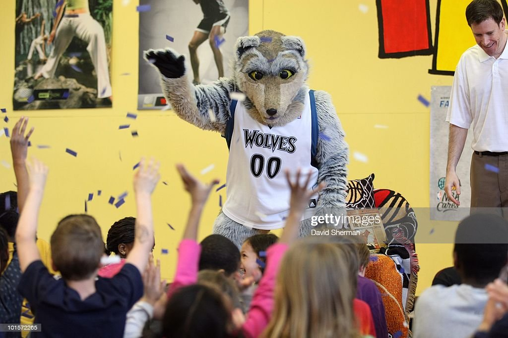 Mascot Crunch of the Minnesota Timberwolves entertaints a group of young kinds during a Reading Time-out at the Midway YMCA on March 29, 2010 in St. Paul, Minnesota.