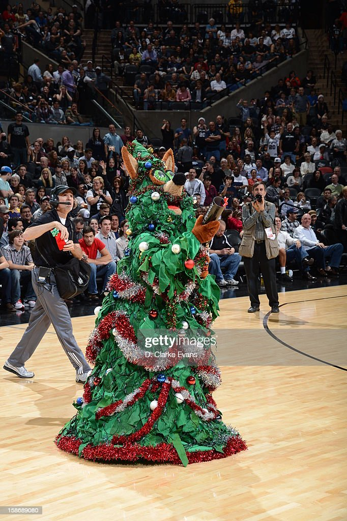 A mascot dressed as a Christmas tree performs during the game between the Dallas Mavericks and the San Antonio Spurs on December 23, 2012 at the AT&T Center in San Antonio, Texas.