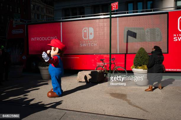 A mascot dressed as Nintendo Co's videogame character Mario stands outside of the company's launch event in New York US on Friday March 3 2017...