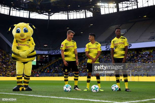 Mascot Emma Macimilian Philipp Mahmoud Dahoud and DanAxel Zagadou are seen during the Borussia Dortmund Season Opening 2017/18 at Signal Iduna Park...