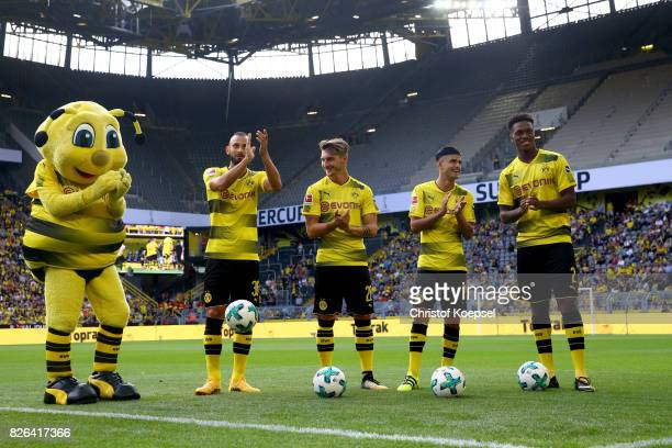 Mascot Emma Oemer Toprak Macimilian Philipp Mahmoud Dahoud and Macimilian Philipp welcome the fans during the Borussia Dortmund Season Opening...