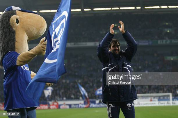 Mascot Erwin and Raúl Gonzalez of Schalke celebrate after winning the Bundesliga match between FC Schalke 04 and SV Werder Bremen at Veltins Arena on...