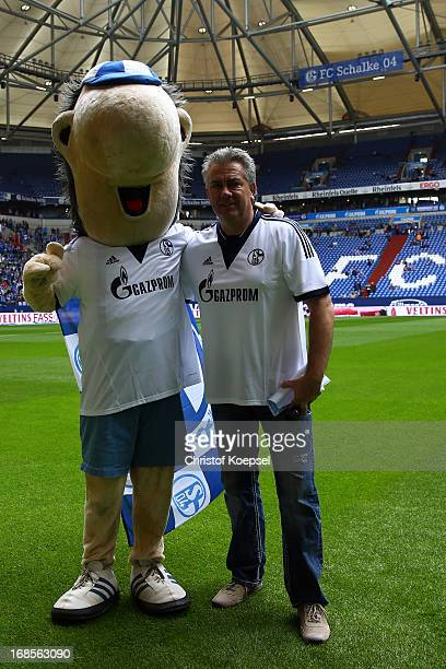 Mascot Erwin and stadium speaker Dirk Oberschulte Beckmann poses prior to the Bundesliga match between FC Schalke 04 and VfB Stuttgart at...