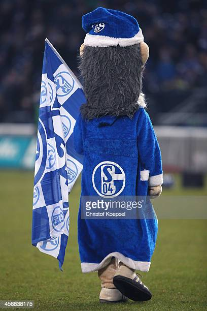 Mascot Erwin of Schalke celebrate after the Bundesliga match between FC Schalke 04 and SC Freiburg at VeltinsArena on December 15 2013 in...