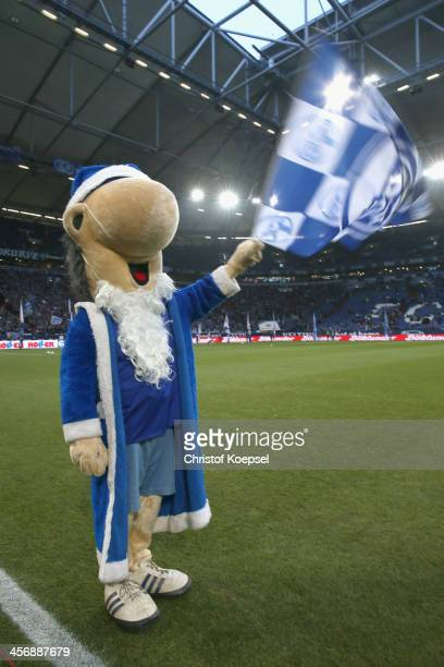 Mascot Erwin of Schalke celebrates after the Bundesliga match between FC Schalke 04 and SC Freiburg at VeltinsArena on December 15 2013 in...
