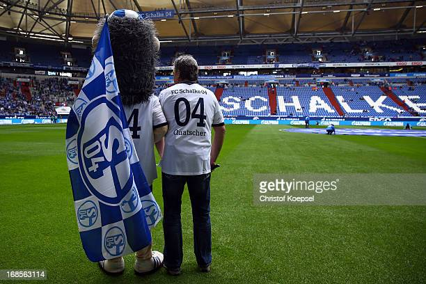 MAscot Erwin poses prior to the Bundesliga match between FC Schalke 04 and VfB Stuttgart at VeltinsArena on May 11 2013 in Gelsenkirchen Germany