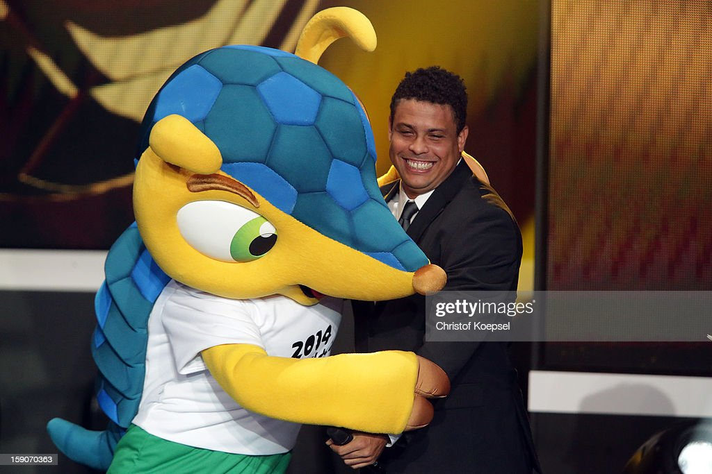 Mascot Fuleco of FIFA World Cup 2014 in Brazil dances with Ronaldo during the FIFA Ballon d'Or Gala 2013 at Congress House on January 07, 2013 in Zurich, Switzerland.