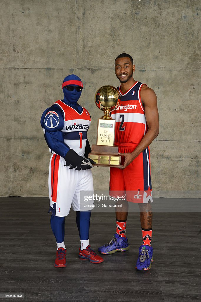 Mascot G-Man and John Wall of the Washington Wizards poses for a portrait with the trophy of the dunker of the night after the East won the Sprite Slam Dunk Contest in the 2014 State Farm Saturday Night on February 15, 2014 at the Smoothie King Center in New Orleans, Louisiana.
