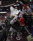 Mascot Harvey the Hound of the Calgary Flames with a fan during the game against Columbus Blue Jackets at the Scotiabank Saddledome on December 1...