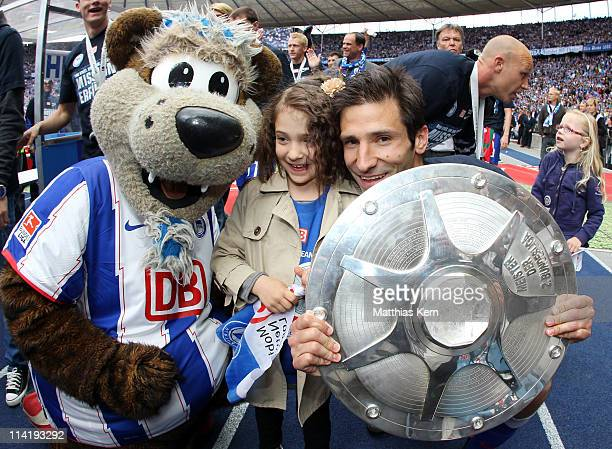 Mascot Herthino of Berlin and Andre Mijatovic with his daughter pose with the trophy after winning the championship after the Second Bundesliga match...