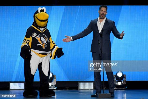Mascot Iceburgh of the Pittsburgh Penguins talks with host Joe Manganiello during the 2017 NHL Awards and Expansion Draft at TMobile Arena on June 21...