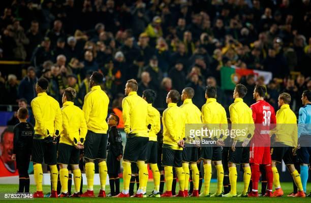 A mascot kid looks up to Dan Axel Zagadou of Dortmund during the UEFA Champions League group H match between Borussia Dortmund and Tottenham Hotspur...