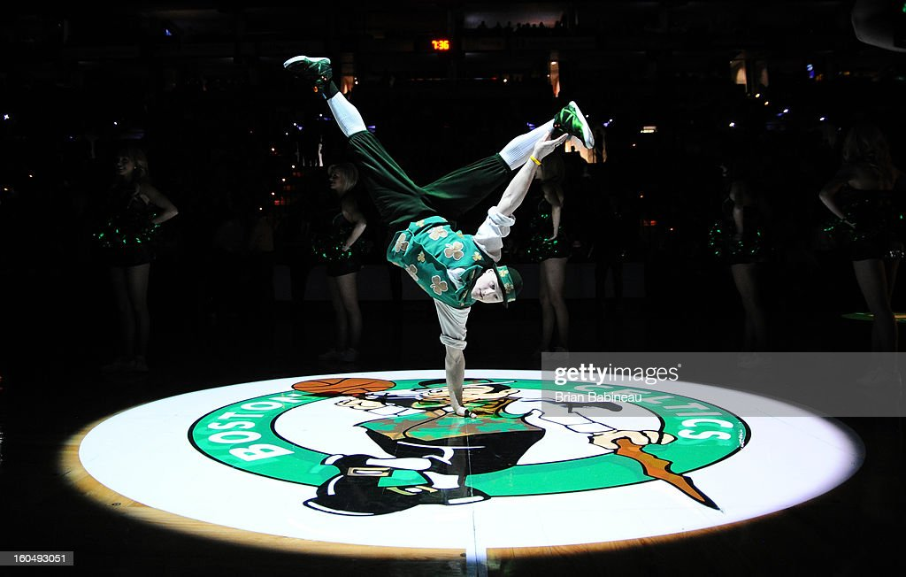 Mascot Lucky of the Boston Celtics does a handstand at center court prior to the game against the Orlando Magic on February 1, 2013 at the TD Garden in Boston, Massachusetts.