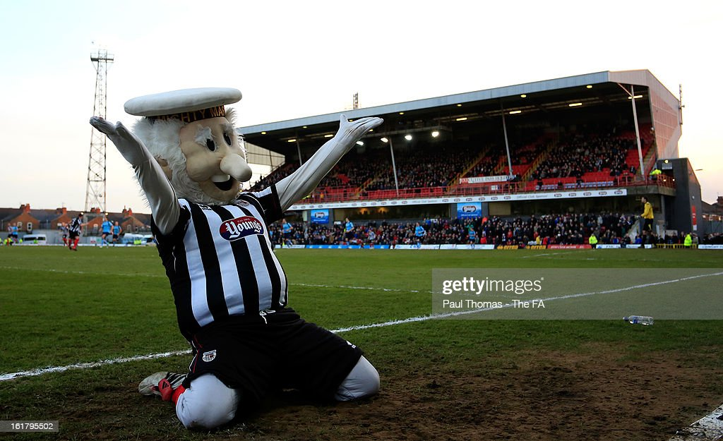 Mascot Mighty Mariner of Grimsby celebrates during the FA Trophy semi final match between Grimsby Town v Dartford at Blundell Park on February 16, 2013 in Grimsby, England.