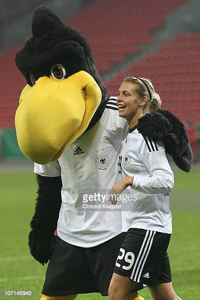 Mascot Paule and Lena Goessling of Germany celebrate the 80 victory after the women's international friendly match between Germany and Nigeria at...
