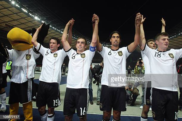 Mascot 'Paule' Christian Traesch Philipp Lahm Sami Khedira Thomas Mueller and Toni Kroos of Germany celebrate after during the EURO 2012 group A...