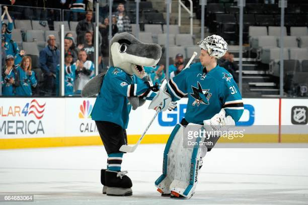 Mascot SJ Sharkie congratulates first star of the game Martin Jones of the San Jose Sharks after a NHL game against the Vancouver Canucks at SAP...