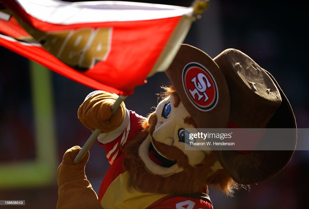 Mascot Sourdough Sam of the San Francisco 49ers runs onto the field waving a 49ers flag during player introduction before their game against the Arizona Cardinals at Candlestick Park on December 30, 2012 in San Francisco, California.